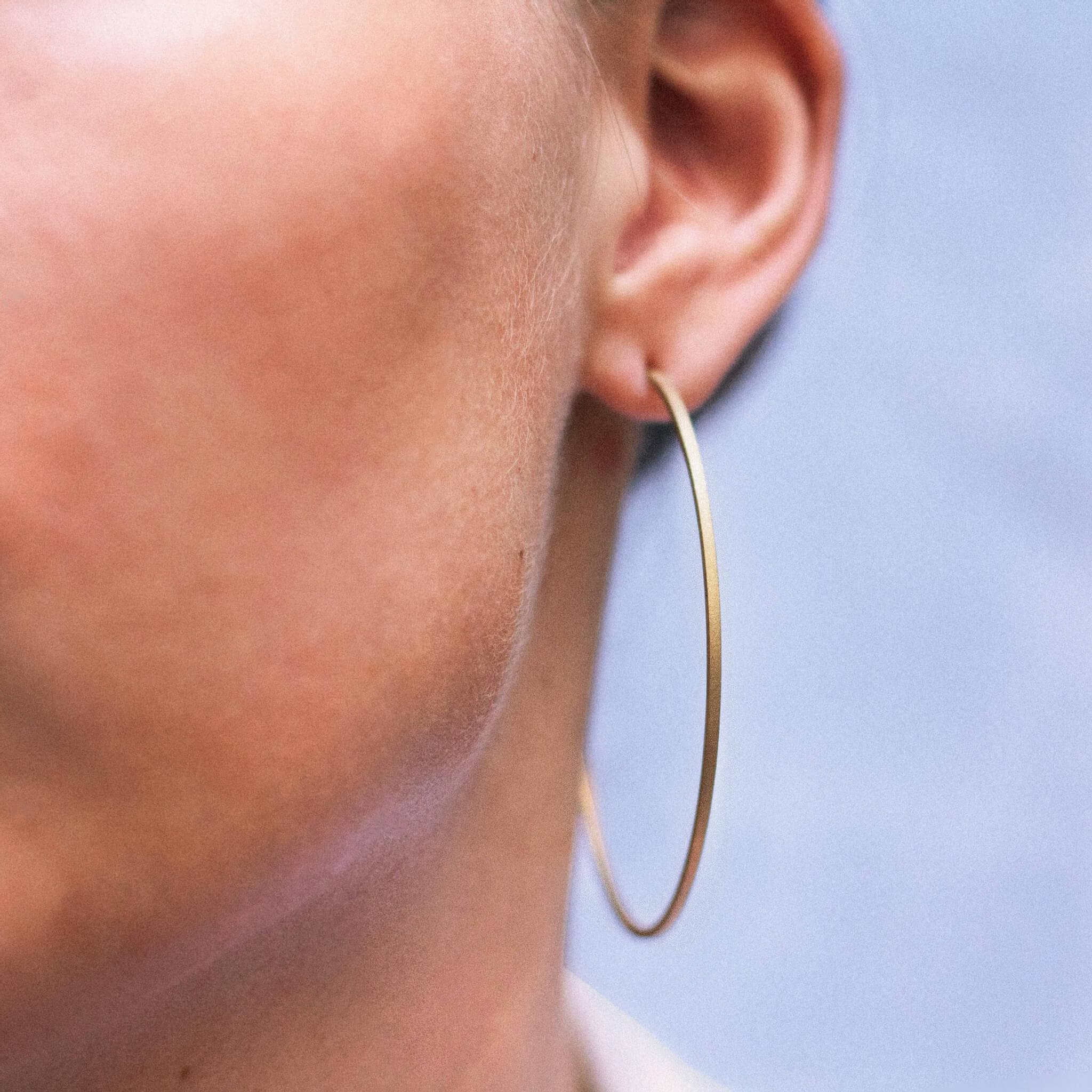 Spirale boucle d'oreilles créole or jaune